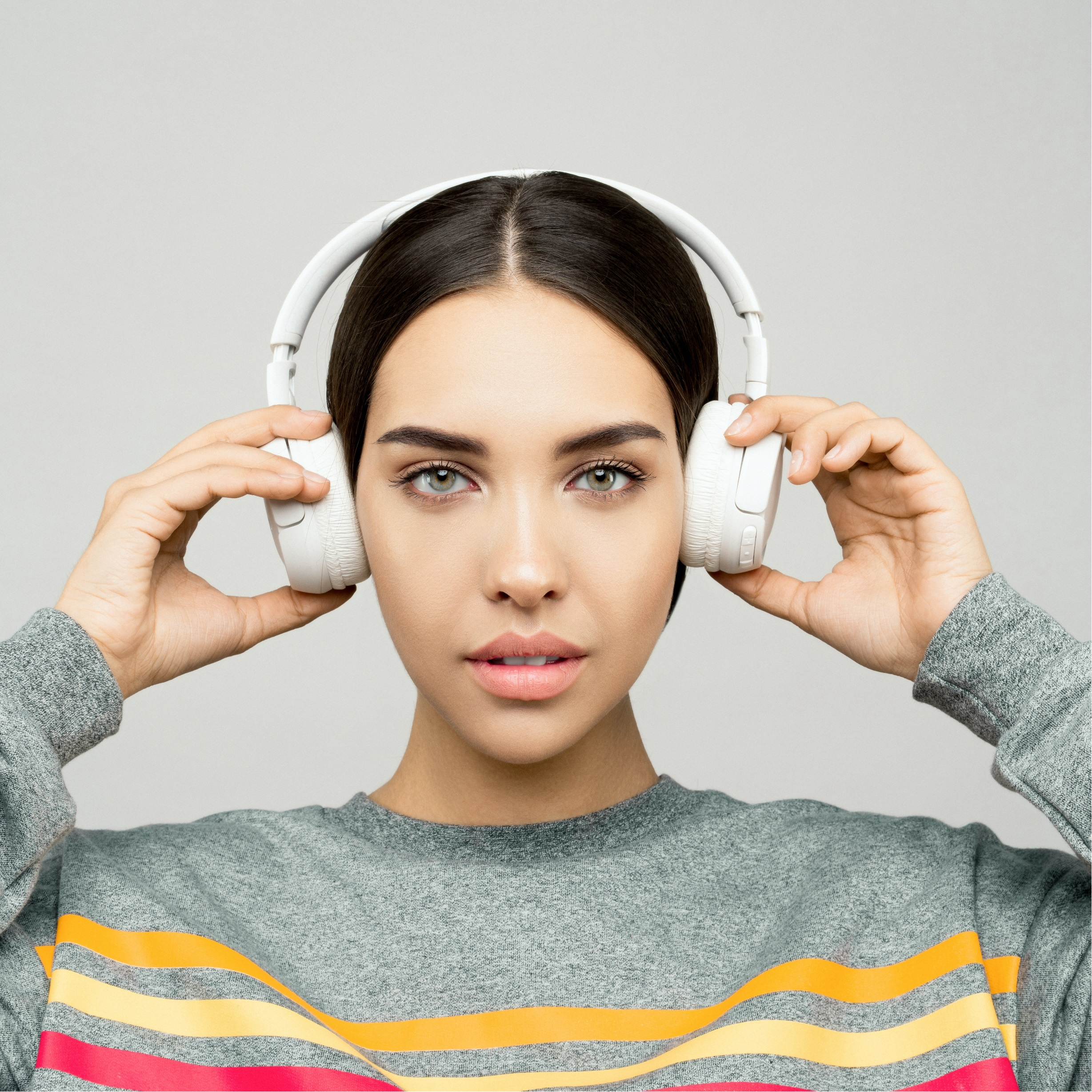 Admin Hacks: A women wearing white headphones.